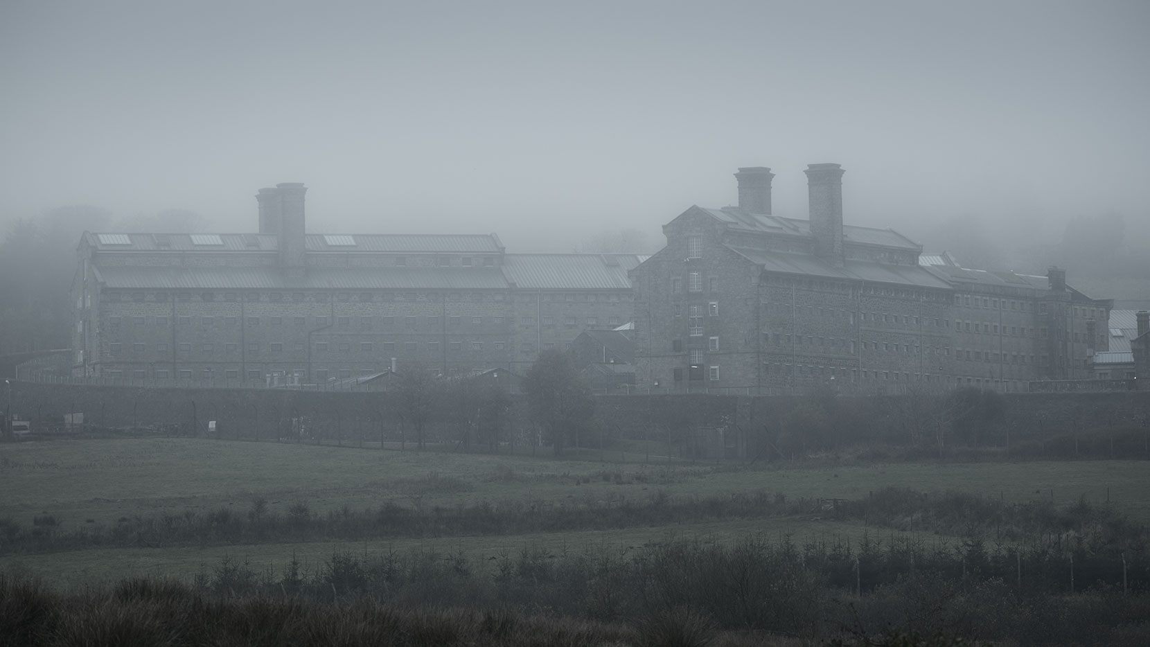 Norman Stanley Fletcher - you are hereby sentenced to five years... industrial and menacing, Dartmoor Prison is fearful place in the fog.