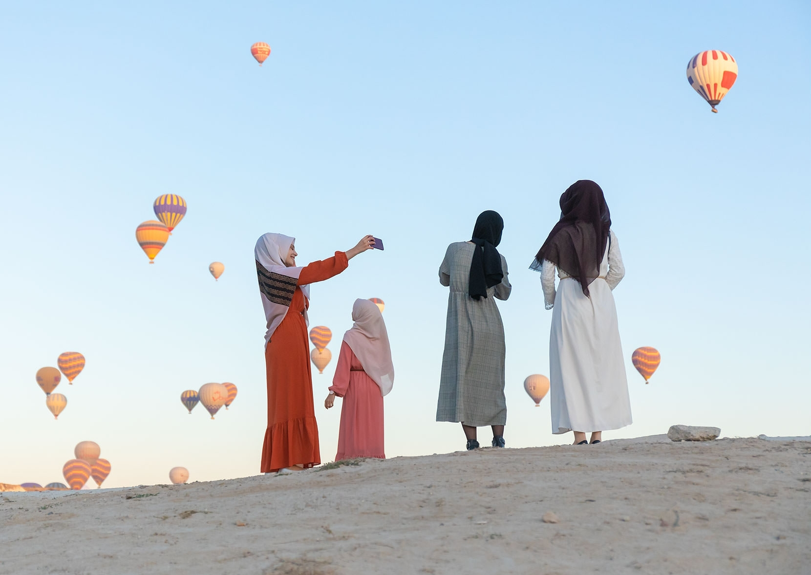 Every country... Muslim girls enjoy ballon backdrops - I was scrabbling for the perfect alignment (everything is moving)